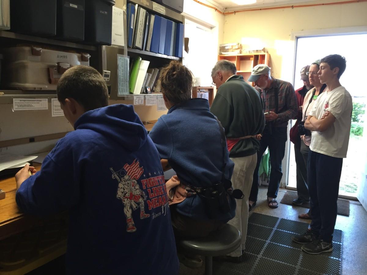 Visitors watching Jeff, Kiah and David hard at work